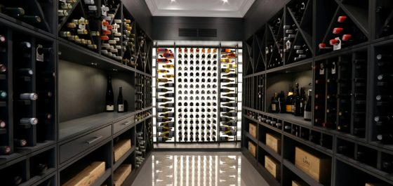 Grey washed oak wine room with acrylic feature wall by Cellar Maison London