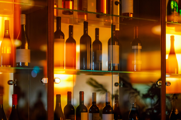 Wine bottles in a glass cabinet