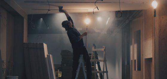 Builder installing kitchen