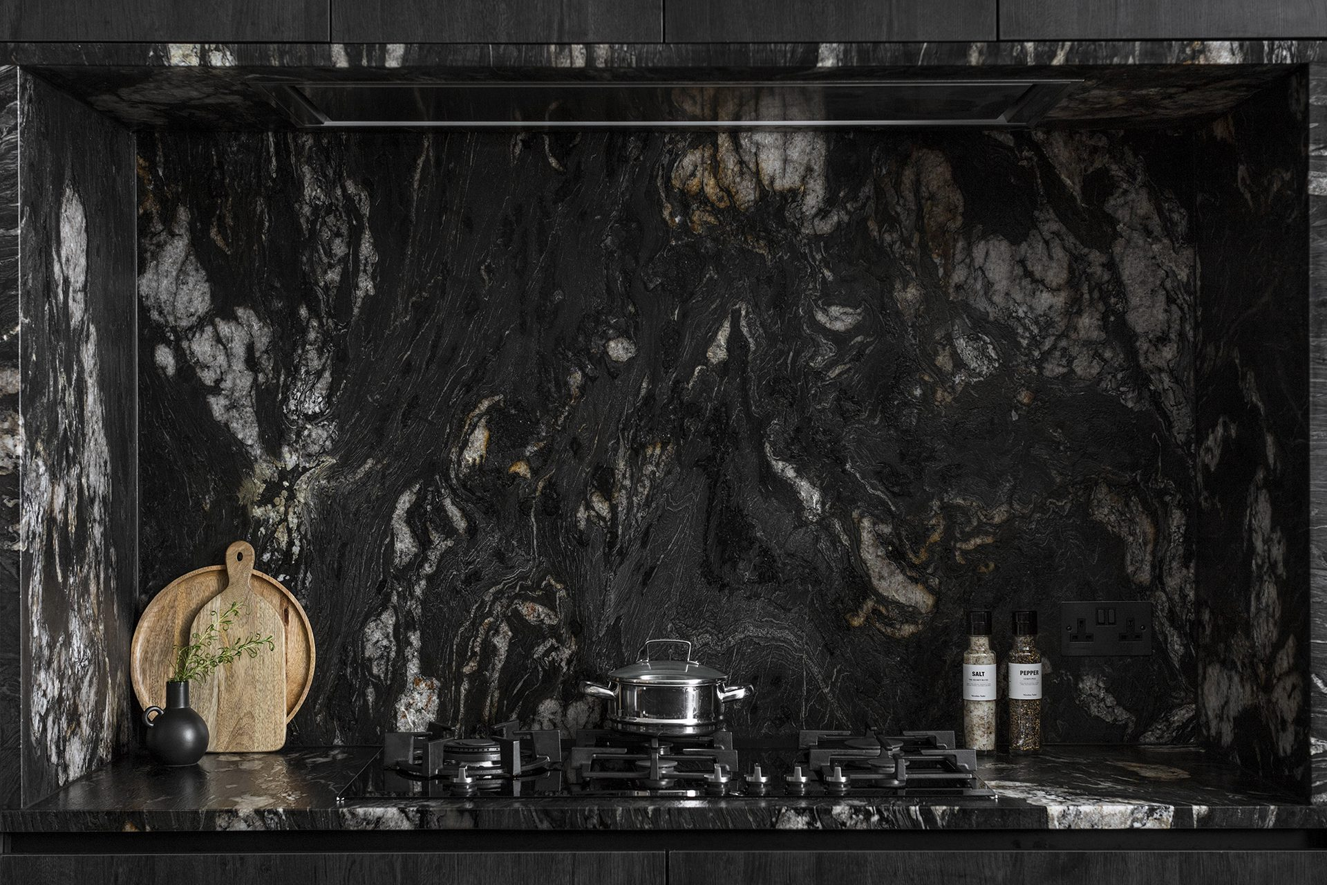 Granite kitchen splashback and gas hob