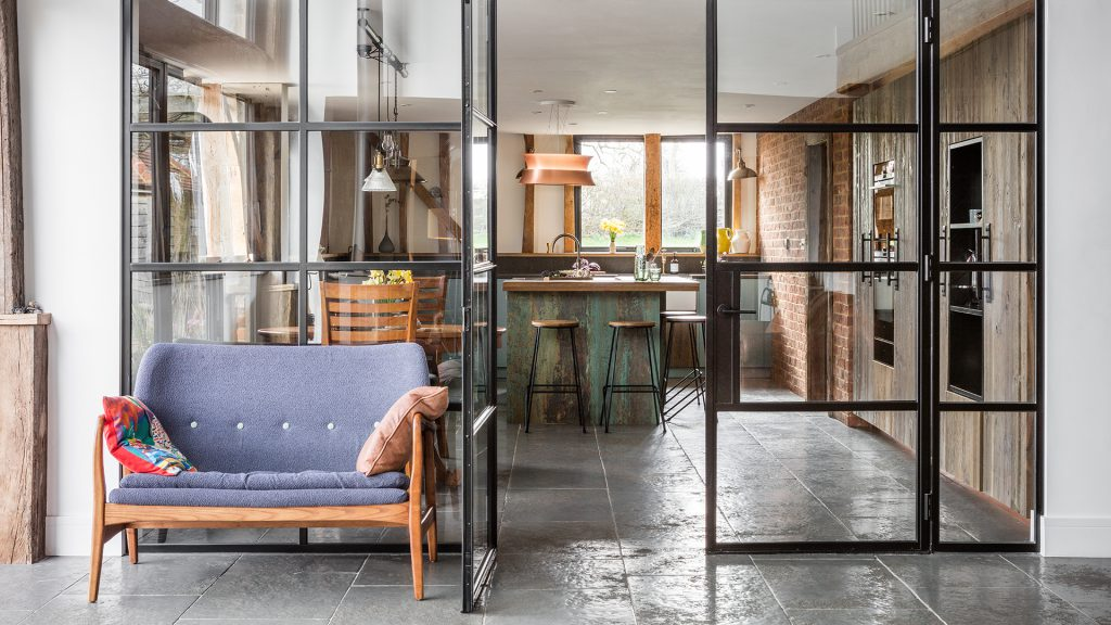 open plan kitchen with crittall glass wall