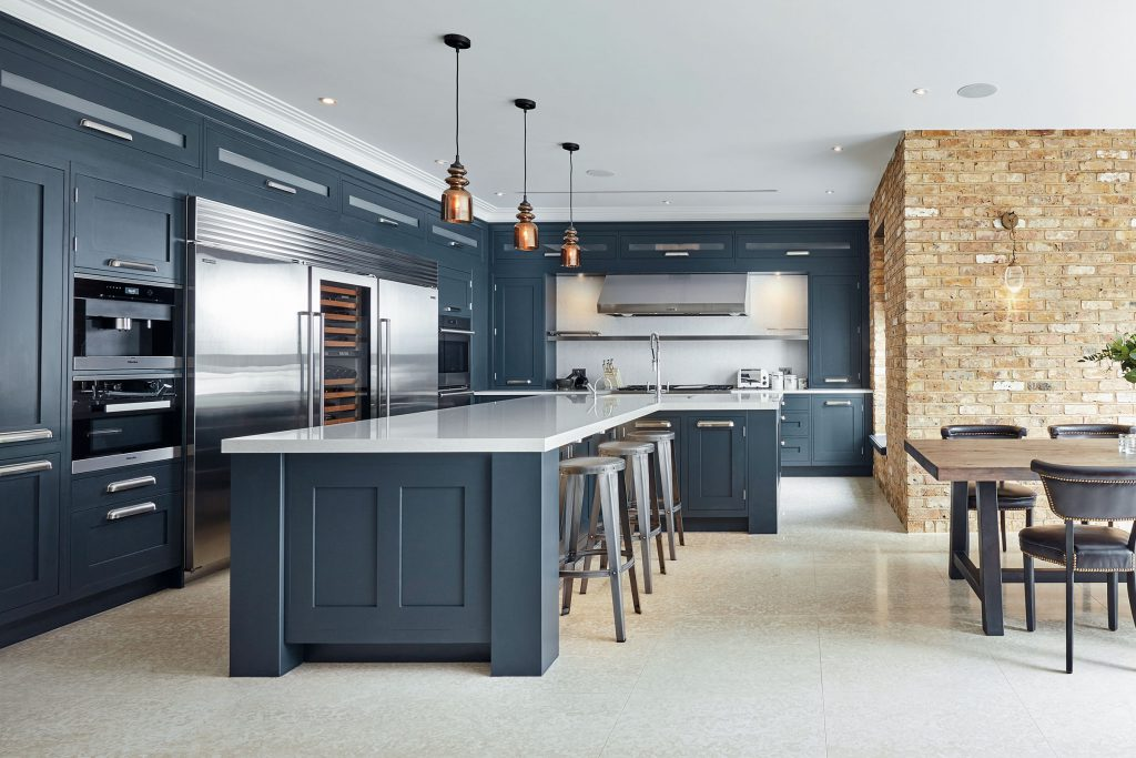 traditional kitchen with pendant lighting above island