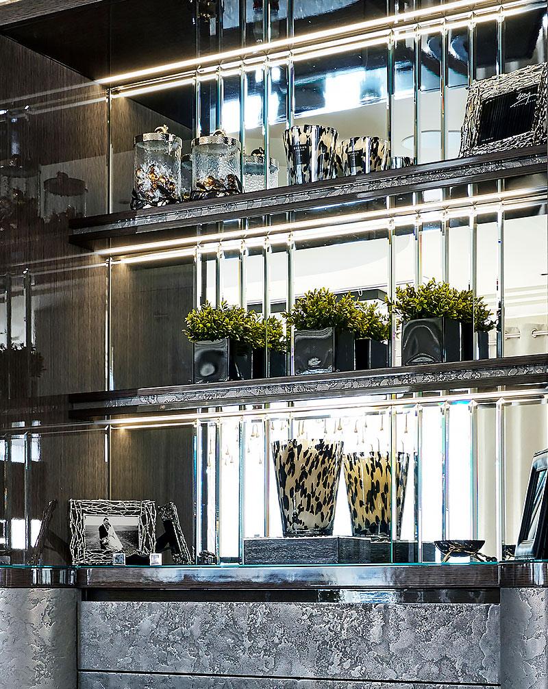 luxury kitchen with shelf lighting & bevelled mirror back panel