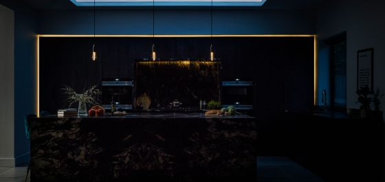 moody dark kitchen at night with accent lighting