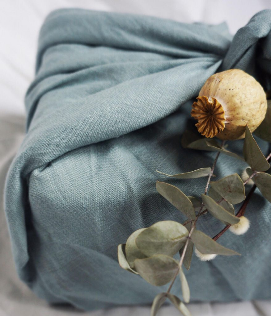 Fabric wrapped gift in blue organic linen